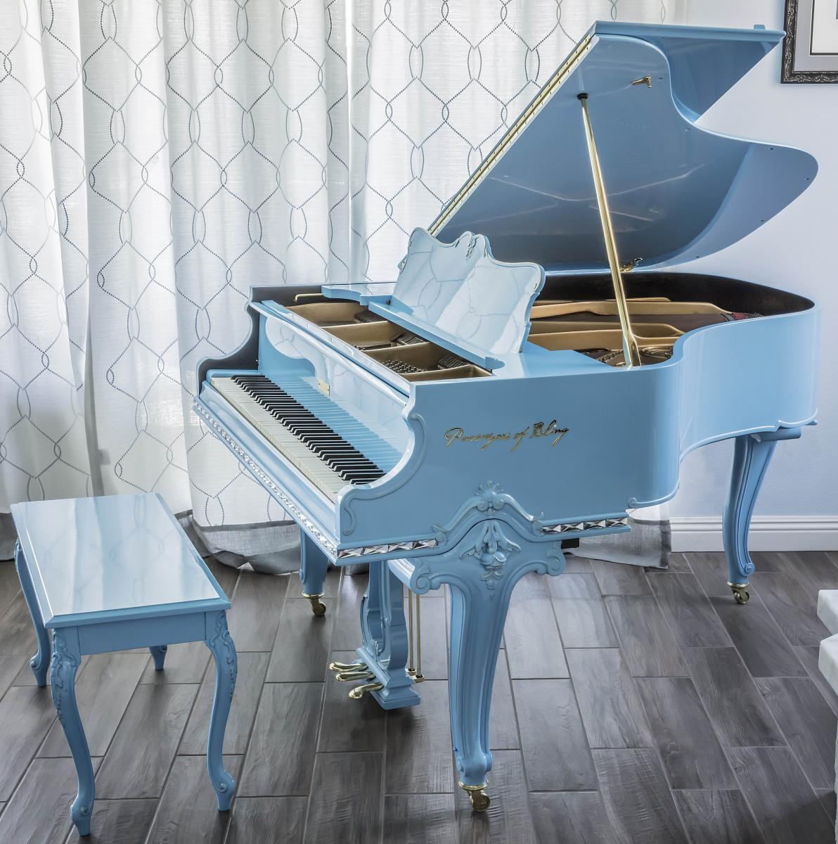restored antique baby grand piano
